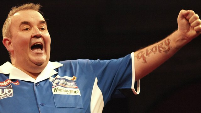 Phil Taylor celebrates winning his 15th world title