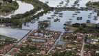 Homes are partially submerged in flood water in La Victoria in southern Colombia, Wednesday 15 December