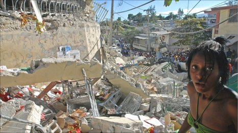 A girl surveys the damage done after the Hait earthquake