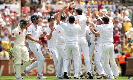 Chris Tremlett is congratulated by England team-mates after picking up thw wicket of Philip Hughes