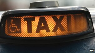 """A taxi """"for hire"""" sign"""