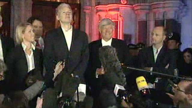 Assange addresses reporters flanked by his legal team