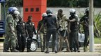 A supporter of Alassane Ouattara is detained by troops in Abidjan, Ivory Coast (16 December 2010)