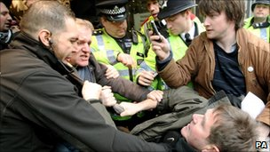 Security guards and police remove UK Uncut demonstrators from Topshop, on London's Oxford Street