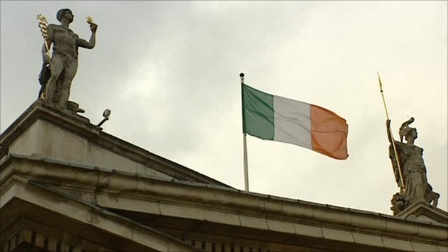Irish flag between two statues
