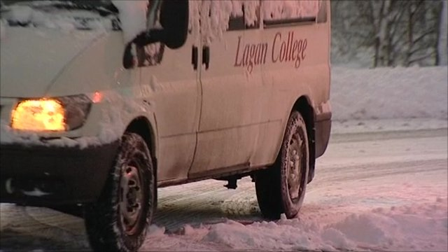 A van drives through snow in Belfast