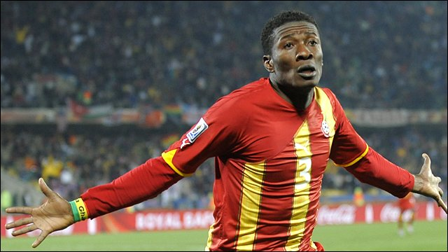 Asamoah Gyan celebrates scoring against USA in the World Cup