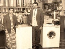 A couple pose with their new washing machine in Milans