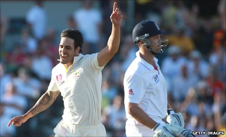 Mitchell Johnson (left) celebrates the wicket of Jonathan Trott (right)
