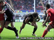 Mike Phillips crosses for a first-half Ospreys try against Munster