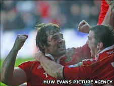 Munster prop Tony Buckley celebrates the opening try of the match