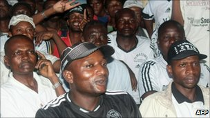 TP Mazembe fans watch match on TV
