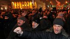 Protesters shout slogans during a rally in Minsk