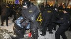 Riot police clash with protesters in Minsk