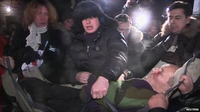 Vladimir Neklyaev being lifted into an ambulance