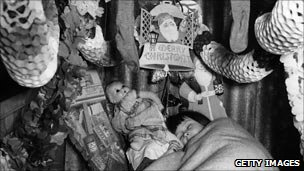 Girl asleep in decorated air raid shelter