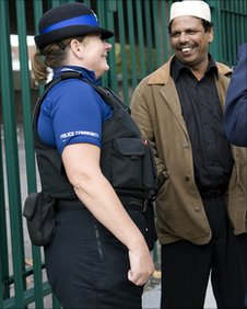 A policewoman talks to a member of the Muslim community