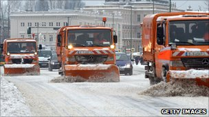 Snow clearing machines clear a street in Berlin, 20 December 2010