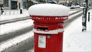 Postbox covered in snow