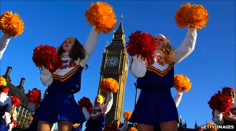 Cheerleaders from the Universal Cheerleaders Association (UCA) from Memphis, Tennessee dance at the parade in 2002.