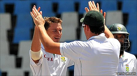 Dale Steyn celebrates taking India's final wicket with captain Graeme Smith
