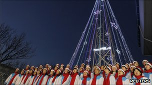 Choristers surround the illuminated tower at Aegibong on 21 December 2010