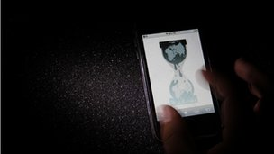 Wikileaks website is pictured on a smartphone