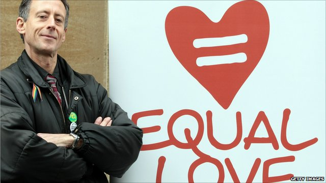 Peter Tatchell in front of Equal Love sign