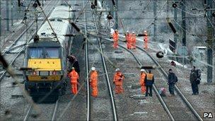 Passengers led off a train outside Huntingdon