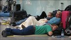 Passengers sleep on the floor of Terminal 3
