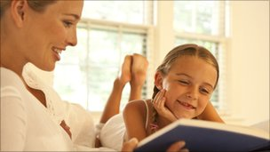 Adult and child reading together [Thinkstock]
