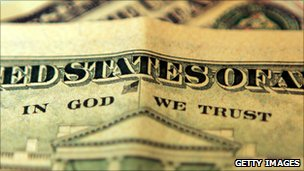 "A ten dollar bill with the phrase ""In God We Trust"""