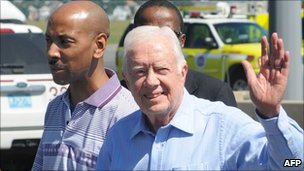 Former US President Jimmy Carter (R) with US national Aijalon Gomes