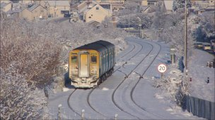 Train making its way through snow near Llandudno Junction, Conwy