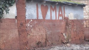 MAL graffiti on wall of house, Devecser