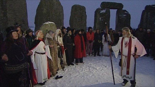 People celebrating the winter solstice at Stonehenge