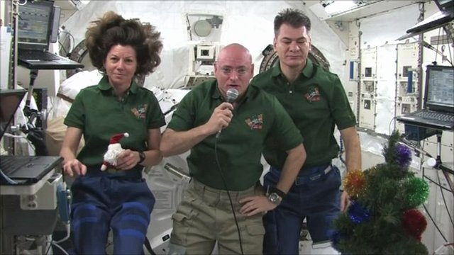 Cady Coleman, Scott Kelly, Paolo Nespoli and floating Christmas tree on board the ISS