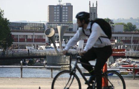 Man on bike in Bristol city centre
