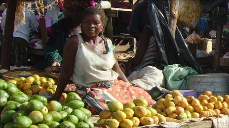 woman selling fruit at market