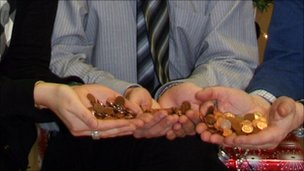 Council workers with pennies
