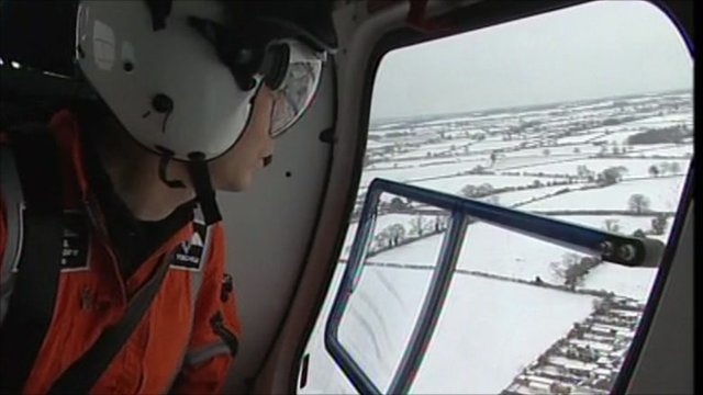 Crew member looking out of the air ambulance