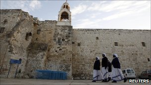 Nuns walk outside the Church of the Nativity in Bethlehem