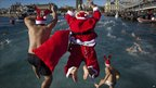 Athletes dressed as Father Christmas jump in the Mediterranean Sea as they take part in the Copa Nadal in Barcelona.