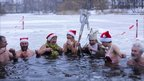 Members of the Berlin Seals swimming club mark Christmas with a dip in the icy Orankesee Lake in the German capital.