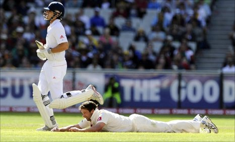 Ben Hilfenhaus of Australia goes to the ground as Alastair Cook of England takes a run