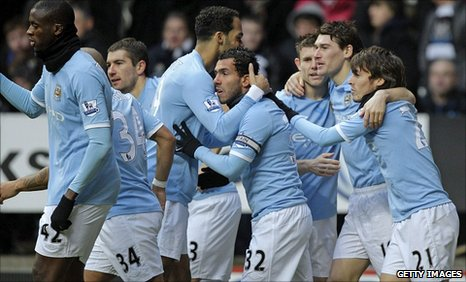 Manchester City players celebrate their second goal at Newcastle