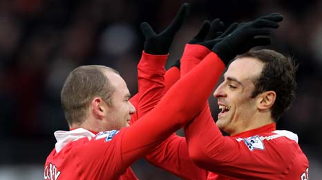 Wayne Rooney and Berbatov are firing United towards the title