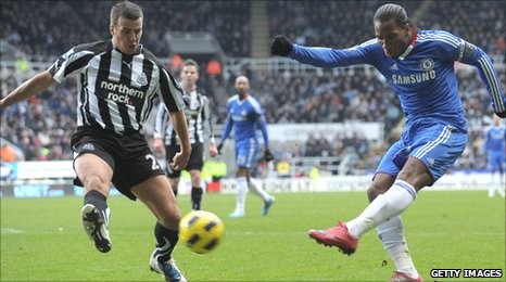 Steven Taylor looks to close down Didier Drogba
