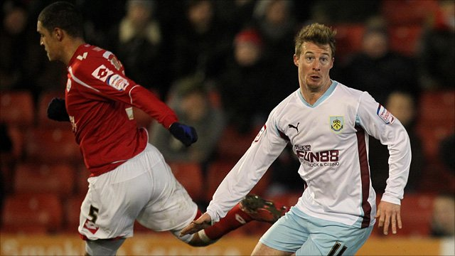Barnsley's Nathan Doyle and Burnley's Wade Elliott (right).