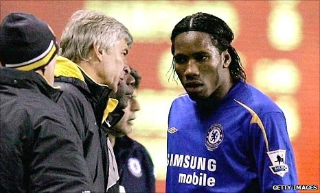 Arsene Wenger and Didier Drogba